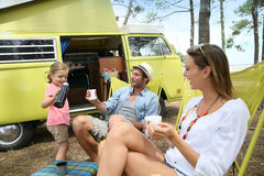 Joyful family spending time on summer holidays camping Stock Photo