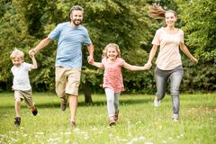 Joyful family with two children Stock Photography