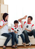 Joyful family watching football match Royalty Free Stock Images