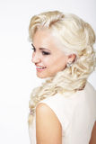 Joyful Fashionable Blond Hair Woman with Plait. Portrait of Smiling Fashionable Blond Hair Woman with Plait Royalty Free Stock Images