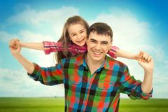 Joyful father with daughter on shoulders. Carefree and happy. Fathers day, family holiday, vacation Royalty Free Stock Images
