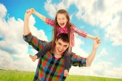 Joyful father with daughter on shoulders Stock Images