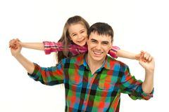 Joyful father with daughter on shoulders. Carefree and happy. Isolated white background. Fathers day, family holiday, vacation Royalty Free Stock Photos