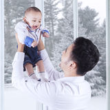 Joyful father and his baby Stock Image