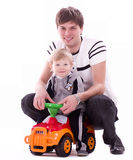 Joyful father and his baby son with small car Stock Photography