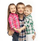 Joyful father hugging his son and daughter. Portrait of joyful father hugging his son and daughter. Fathers day, family holiday, vacation. Isolated white Royalty Free Stock Photos