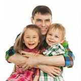 Joyful father hugging his son and daughter. Portrait of joyful father hugging his son and daughter. Isolated on white background. Fathers day, family holiday Stock Photography