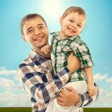 Joyful father with son carefree and happy. Fathers day, family holiday, vacation Stock Photos