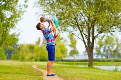 Joyful father and son having fun in park Stock Image