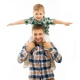 Joyful father with son on shoulders. Carefree and happy. Fathers day, family holiday, vacation. Isolated white background Stock Photo