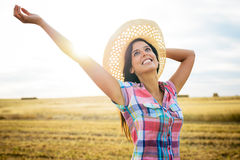 Joyful female farmer success in agriculture business. Blissful female farmer enjoying success and freedom in countryside field. Successful agriculture farm Royalty Free Stock Images