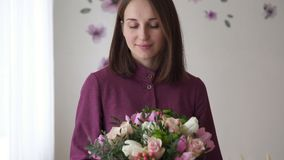 Portrait of florist woman with bouquet made by her stock footage