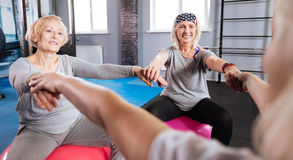 Joyful female friends enjoying their fitness workout Royalty Free Stock Photo