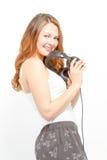 Joyful female holds headphones around neck Stock Image