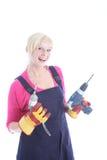 Joyful female worker. Holding two drills isolated on white Stock Photography