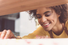 Joyful female worker is expressing gladness Royalty Free Stock Images