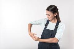 Joyful female worker holding helmet Stock Image