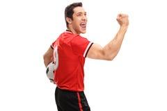 Joyful football player celebrating a goal Royalty Free Stock Image
