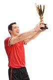 Joyful football player lifting a trophy Royalty Free Stock Image