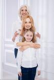 Joyful friendly family embracing Royalty Free Stock Photo