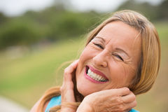 Joyful friendly senior woman outdoor Stock Photo