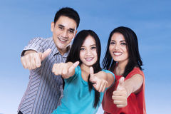 Joyful friends giving thumbs up Royalty Free Stock Photography