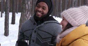 Joyful friends having coffee in snowy forest stock video