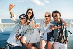 Joyful friends having fun outdoors together Stock Photo