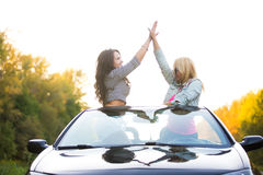 Joyful friends on road trip royalty free stock photography
