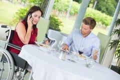 Joyful friends sitting at restaurant. Joyful friends sitting at a restaurant Stock Images