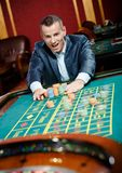 Joyful gambler stakes playing roulette Royalty Free Stock Photography