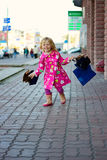 Joyful Girl 3 years with shopping Stock Photography