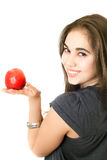 Joyful girl with an apple Royalty Free Stock Photography