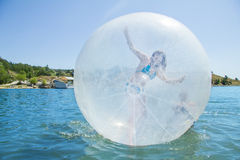 Joyful girl in a balloon floating on water. Stock Photo