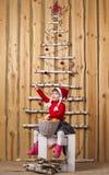 Joyful girl with basket of tangerines Stock Image