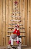 Joyful girl with basket of tangerines Stock Photo