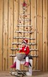 Joyful girl with basket of tangerines Stock Photos