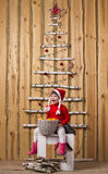 Joyful girl with basket of tangerines Royalty Free Stock Photography