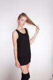Joyful girl in a black dress Stock Photos