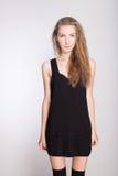 Joyful girl in a black dress Royalty Free Stock Photography