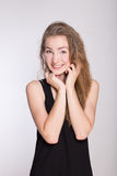 Joyful girl in a black dress Stock Image