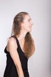 Joyful girl in a black dress Stock Photography