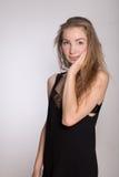 Joyful girl in a black dress Royalty Free Stock Photo
