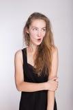 Joyful girl in a black dress Stock Images