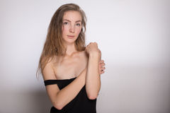 Joyful girl in a black dress Royalty Free Stock Images