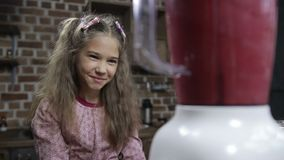 Joyful girl blending berry smoothie in the kitchen stock video