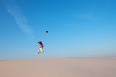 Joyful girl, blonde jumps delighted by the journey Royalty Free Stock Image