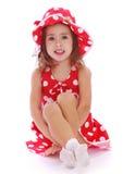 Joyful girl in a bright red Panama Stock Image