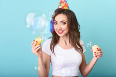Joyful girl celebrating her birthday royalty free stock photography