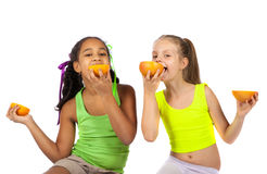 Joyful girl with citrus Royalty Free Stock Image